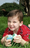 Easter eggs 13. A young boy holding two Easter eggs and making a funny face royalty free stock photo