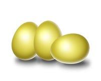 Easter eggs. Three golden easter eggs isolate in white Stock Image