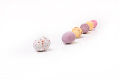 Easter Eggs. Candy covered small chocolate easter eggs frow low viewpoint against white background Royalty Free Stock Image