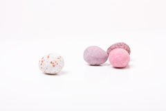 Easter Eggs. Candy covered small chocolate easter eggs frow low viewpoint against white background Stock Photos