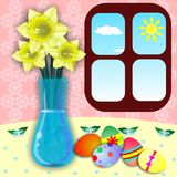 Easter eggs. Painted Easter eggs are on table with vase Royalty Free Stock Image