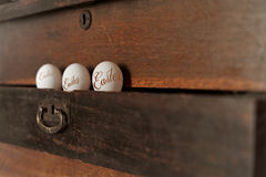 Easter eggs. Three Easter eggs in the drawer stock photos