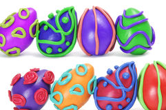 Easter eggs. Some plasticine easter eggs of different colors isolated on a white background Royalty Free Stock Photos