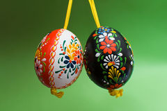 Easter Eggs. Two painted Easter eggs on the green background stock photos