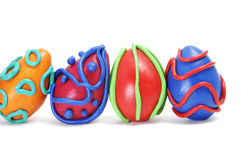 Easter eggs. Some plasticine easter eggs of different colors isolated on a white background Royalty Free Stock Images