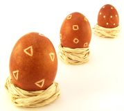 Easter Eggs. On white background. Three decorated eggs in nests Stock Photography