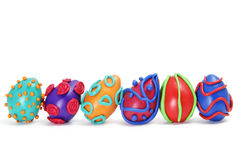 Easter eggs. Some plasticine easter eggs of different colors isolated on a white background Royalty Free Stock Image