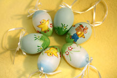 Easter eggs. Artificial Easter eggs on yellow drapery background Royalty Free Stock Photos