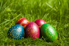 Easter eggs. Colorfull Easter Eggs on the grass with out of focus background Stock Photos