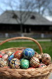 Easter eggs. In a basket and a old house in background Stock Photo