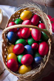 Easter eggs. Colored easter eggs in a wooden basket Royalty Free Stock Photo
