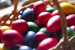 Easter eggs. Colored easter eggs in a wooden basket Stock Images