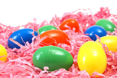 Easter Eggs. A variety of plastic Easter eggs on pink paper shreds Stock Photos