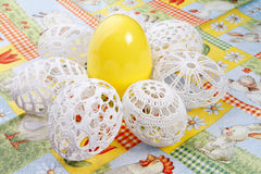 Easter eggs. Crocheted white easter eggs around yellow egg Royalty Free Stock Image