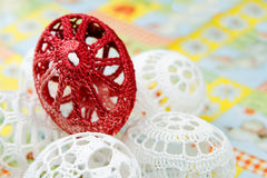 Easter eggs. Crocheted white easter eggs around red egg detail Royalty Free Stock Photography