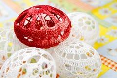 Easter eggs. Crocheted white easter eggs around red egg detail Royalty Free Stock Image