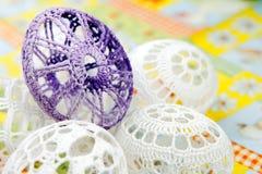 Easter eggs. Crocheted white easter eggs around purple egg detail Stock Photos