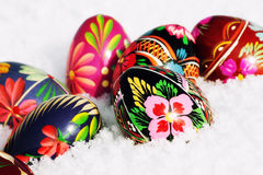 Easter eggs. Colored easter eggs on snow Royalty Free Stock Photo