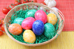 Easter Eggs. Some colourful easter eggs in a basket stock photos