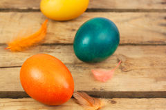 Easter eggs. Three easter eggs on wooden floor Royalty Free Stock Photography