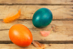 Easter eggs. Three easter eggs on wooden floor Royalty Free Stock Photos
