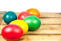 Easter eggs. Colorful easter eggs on wooden floor over white background Royalty Free Stock Photography