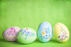 Easter eggs. With flower decorations over old grunge background with copy space Royalty Free Stock Photos