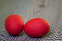 Easter eggs. Two red easter egg on a wood backround Stock Images