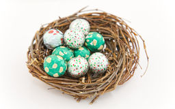 Easter eggs. White and green easter eggs in a nest Royalty Free Stock Photography
