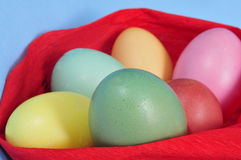Easter eggs. Some easter eggs of different colors on a blue background Royalty Free Stock Image