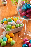 Easter eggs. On a wooden table with some decoration element stock image