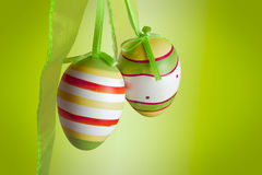 Easter eggs. With a ribbon on green background Royalty Free Stock Photo