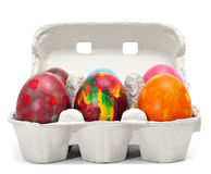 Easter eggs. Some easter eggs of different colors on a carton Stock Photos