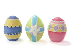 Easter eggs. Three, pastel colored, wax Easter eggs on white background royalty free stock photography