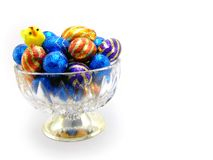 Easter Eggs. A close-up of differend chocolate easter eggs in colorful wrapping. Horizontal version with toy chick Stock Image