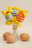 Easter eggs. Colorful easter eggs in the vase and white egggs Stock Images