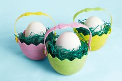 Easter eggs. In colorful little baskets Stock Images