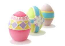 Easter eggs. Pastel colored, wax Easter eggs on white background. Shallow DOF with focus on the front egg royalty free stock image