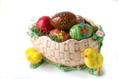 Easter eggs. In the porcelain basket isolated on a white backgrounds Stock Photos