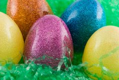 Easter eggs. Close up of plastic easter eggs on artificial grass stock image