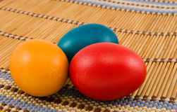 Easter eggs. Three easter eggs on bamboo mat Stock Photos