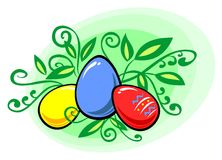 Easter eggs. Multi-coloured easter eggs on a green background with leaves Royalty Free Stock Photos