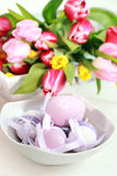 Easter eggs. With tulips as table decoration Stock Photos