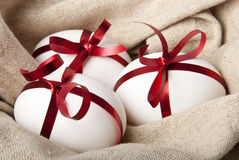 Easter Eggs. Gift eggs on the background of burlap Royalty Free Stock Image