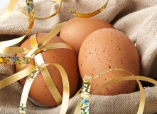 Easter Eggs. Gift eggs on the background of burlap Royalty Free Stock Photos
