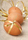 Easter Eggs. Gift eggs on the background of burlap Stock Images
