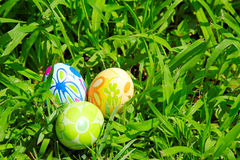 Easter Eggs. Three painted easter eggs on the green grass background Stock Photo