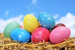 Easter eggs. Some easter eggs of different colors on straw Stock Image