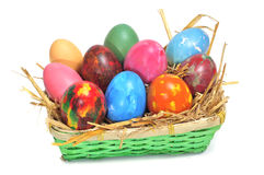Easter eggs. Some easter eggs of different colors in a basket Stock Images