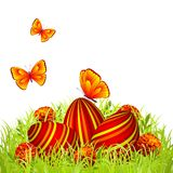 Easter eggs. Three Easter eggs in the grass with flowers and butterflies Royalty Free Stock Images